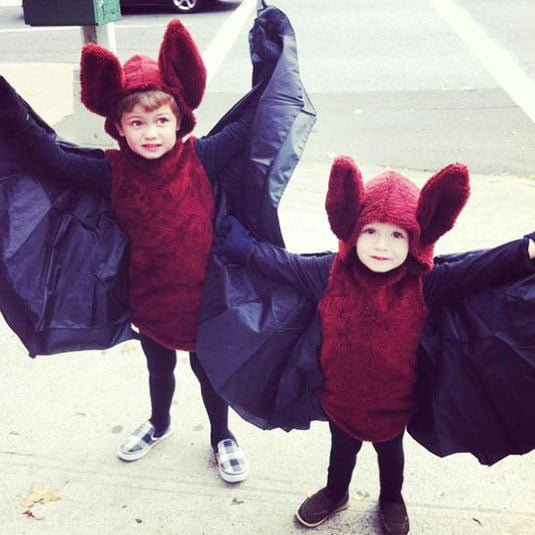two kids with halloween bat dress